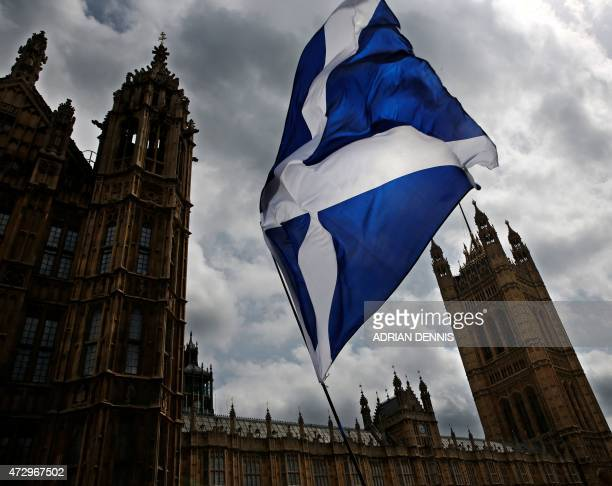 A member of public flies a giant Scottish Saltire flag outside the Houses of Parliament shortly before Scotland First Minister Nicola Sturgeon posed...