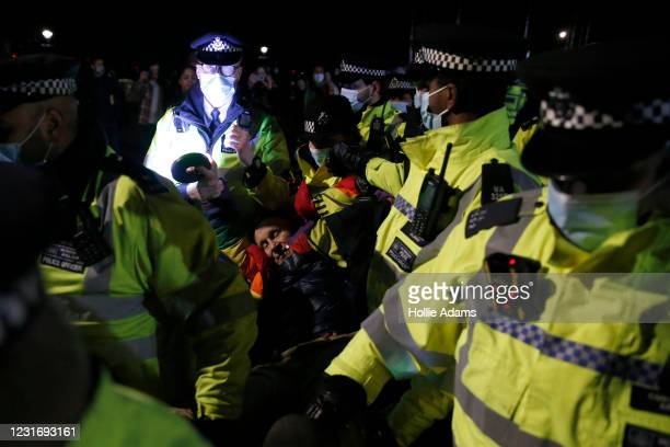 Member of public is arrested during a vigil for Sarah Everard on Clapham Common on March 13, 2021 in London, United Kingdom. Vigils are being held...