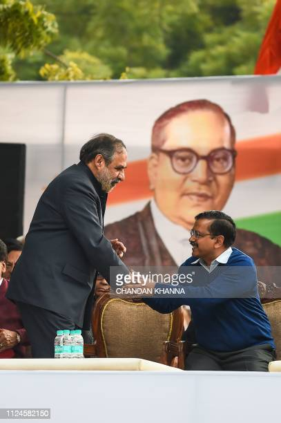 Member of Rajya Sabha Anand Sharma and Chief Minister of the Delhi Arvind Kejriwal attend an opposition political rally in New Delhi on February 13...
