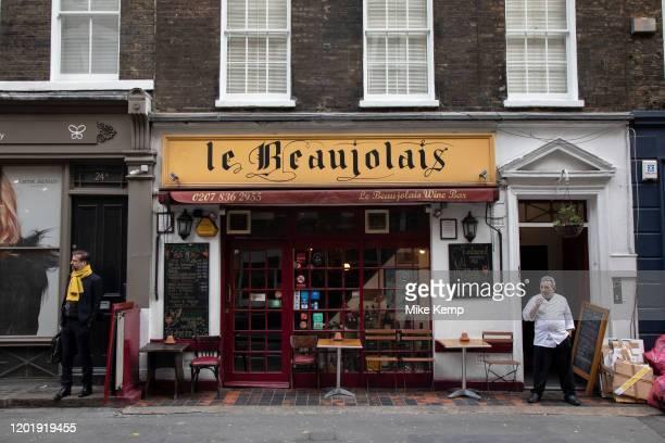 Member of restaurant staff taking a cigarette break outside Le Beaujolais wine bar on 18th February 2020 in London England United Kingdom On the...