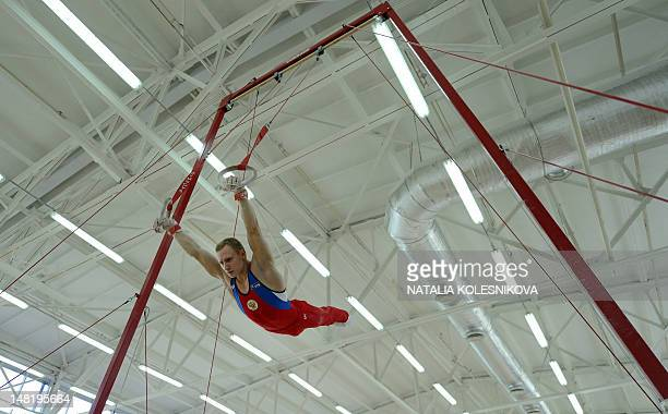 Member of Russia Gymnastics men's team Aleksandr Balandin performs during a training session outside Moscow on July 12 2012 AFP PHOTO / NATALIA...