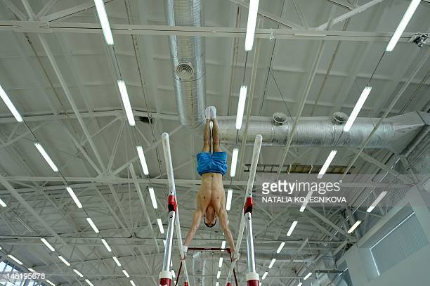 Member of Russia Gymnastics men's team Emin Garibov performs during a training session outside Moscow on July 12 2012 AFP PHOTO / NATALIA KOLESNIKOVA