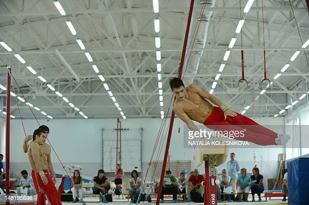 Member of Russia Gymnastics men's team Nikita Ignatiev performs during a training session outside Moscow on July 12 2012 AFP PHOTO / NATALIA...
