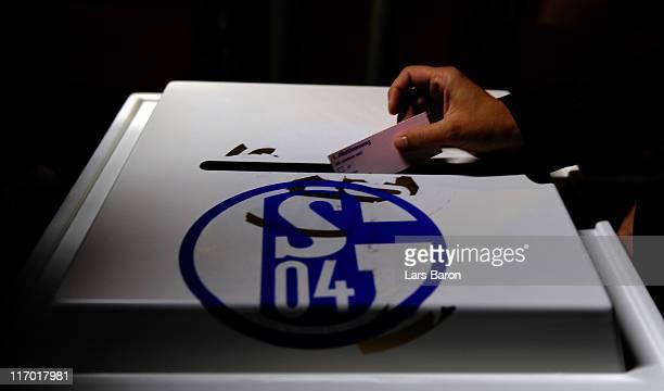 A member of Schalke casts a ballot during the Schalke 04 annual general meeting at Emscher Lippe Halle on June 19 2011 in Gelsenkirchen Germany