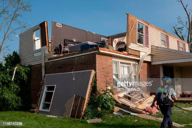 A member of search and rescue inspects a home in Trotwood Ohio on May 28 after powerful tornadoes ripped through the US state overnight causing at...