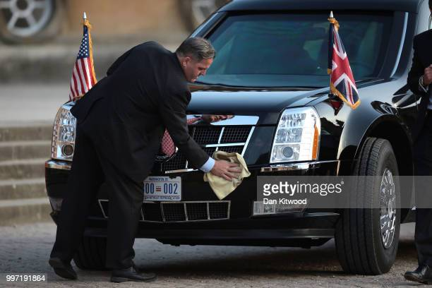 A member of security cleans the limousine of US President Donald Trump and First Lady Melania Trump at Blenheim Palace on July 12 2018 in Woodstock...