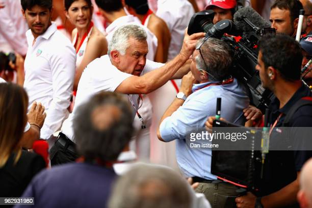 A member of security has an argument with a member of the media before the Monaco Formula One Grand Prix at Circuit de Monaco on May 27 2018 in...
