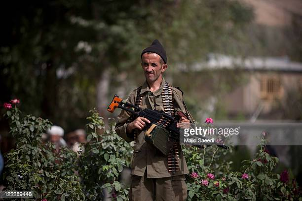 A member of security stands guard at a ceremony as a group of more than 100 Taliban surrender themselves to the Afghan Government on August 26 2011...