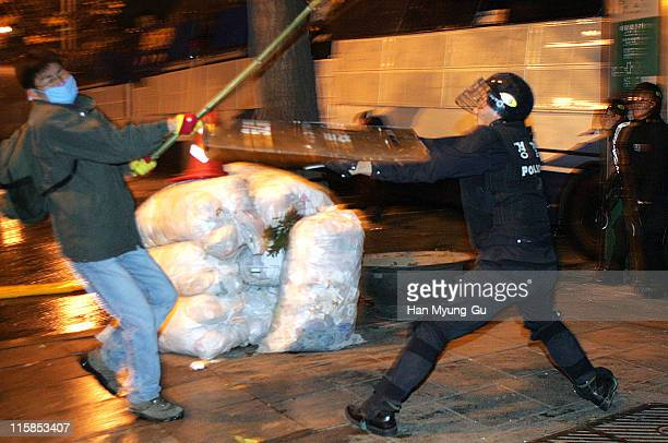 A member of South Korean Farmers clash with riot police during an antiWTO rally on November 13 2004 in Seoul South Korea 15000 South Korean farmers...