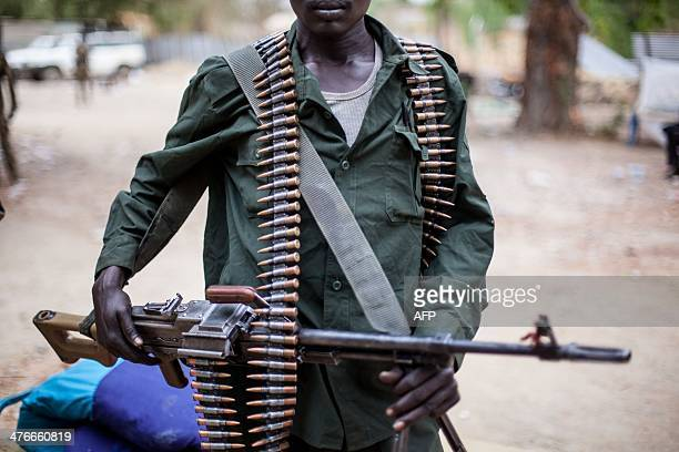 A member of South Sudanese antigovernment forces poses for a photo with his machine gun on March 4 in Malakal South Sudan Almost 40000 people may...