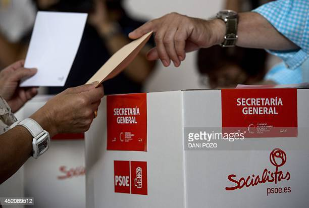 A member of Spain's Socialist Party casts his ballot at a polling station in Madrid on July 13 2014 After humiliating election defeats Spain's...