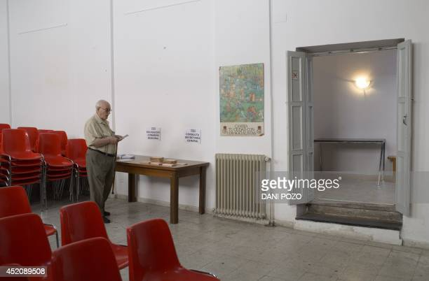 A member of Spain's Socialist Party waits to cast his ballot at a polling station in Madrid on July 13 2014 After humiliating election defeats...