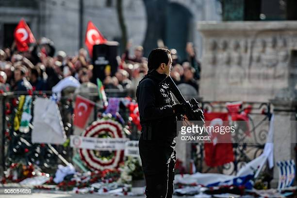 A member of special police forces guards on January 15 2016 a memorial at the site of the suicide bombing blamed on the Islamic State group that...
