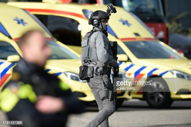 A member of special police forces patrols on March 18 2019 in Utrecht near a tram where a gunman opened fire killing at least three persons and...