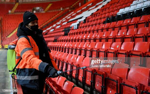 Member of stadium staff disinfects the seats where fans were sitting following the Sky Bet League One match between Charlton Athletic and Milton...