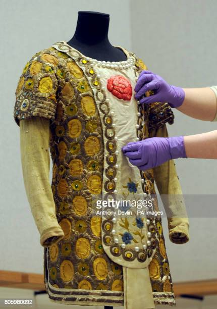 A member of staff adjusts a costume designed by Leon Bakst and worn by Nijinsky in Le Festin during the press launch for Diaghilev and the Golden Age...