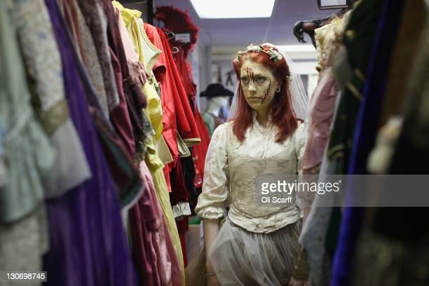 A member of staff at Angels Fancy Dress shop works in their Shaftsbury Avenue branch in a Halloween costume on October 28 2011 in London England Many...
