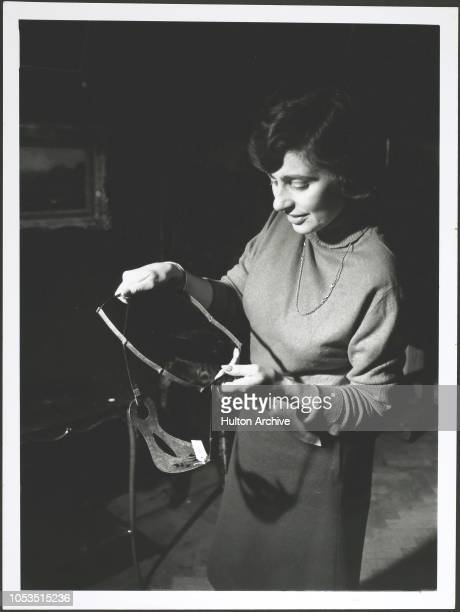 A member of staff at Christie's auction house in London holding a chastity belt which was withdrawn from sale It will be returned to the Tower of...
