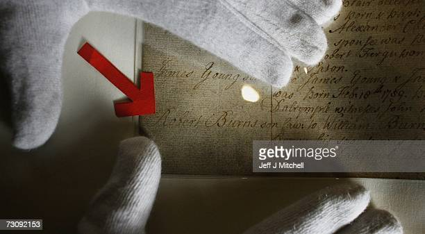 A member of staff at the General Register Office for Scotland holds the birth certificate of Robert Burns on January 24 2006 in Edinburgh Scotland...