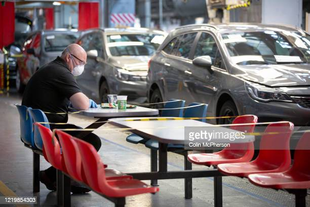 Member of staff at the Vauxhall car factory demonstrating distancing measures necessary when on a break during preparedness tests and redesign ahead...