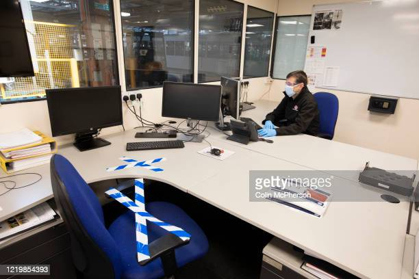 Member of staff at the Vauxhall car factory working in his office during preparedness tests and redesign ahead of re-opening following the COVID-19...