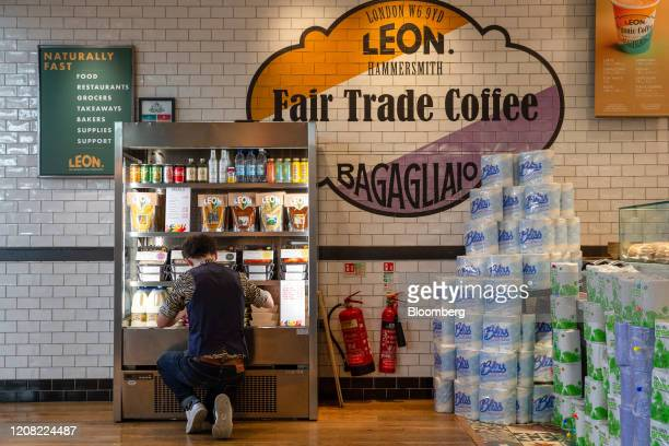 A member of staff checks stock in a fridge at a Leon Restaurants Ltd fast food outlet as they have adapted their business to support their supply...