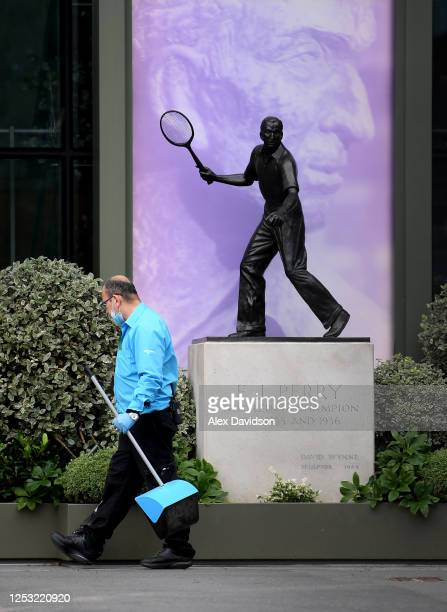 A member of staff cleans at The All England Tennis and Croquet Club on June 29 2020 in Wimbledon England The Wimbledon Tennis Championships were due...