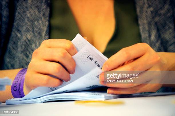 Member of staff counts ballots at the main Glasgow counting centre in Emirates Arena in Glasgow, Scotland, on June 8 after the polls closed in...