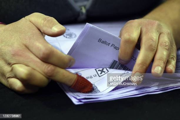Member of staff counts ballots for the Scottish parliament elections at the count centre at the Emirates Arena in Glasgow on May 7, 2021.