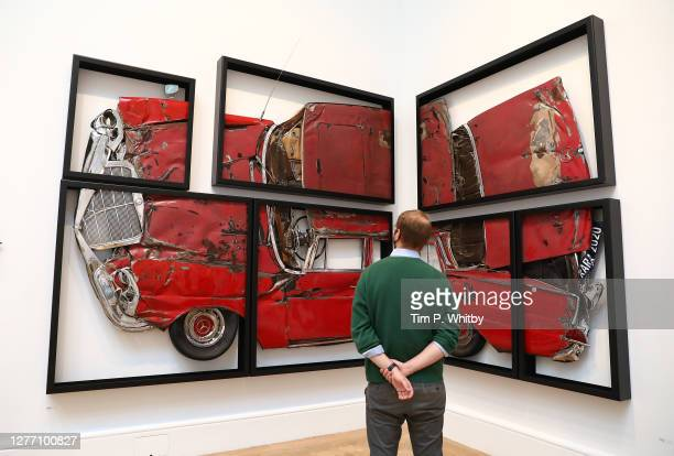 Member of staff inspects 'Oh Lord, Won't You Buy Me?' by Ron Arard RA during the press preview of the Summer Exhibition 2020 at The Royal Academy on...