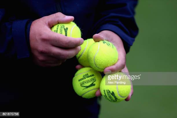 A member of staff is pictured holding several tennis balls during the 2017 Wimbledon qualifying session on June 27 2017 in London England