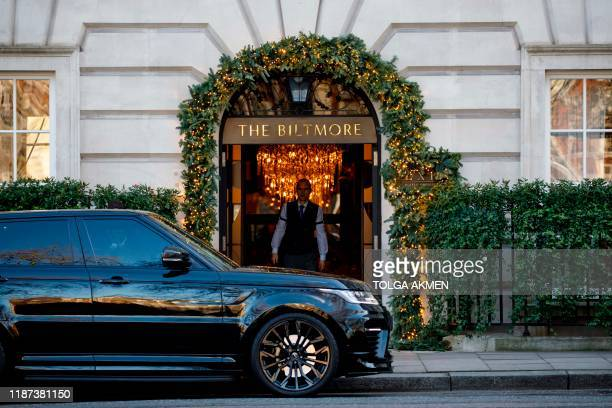 Member of staff is seen in the doorway of The Biltmore Mayfair luxury hotel in London on December 9, 2019. - Despite Brexit and the economic...