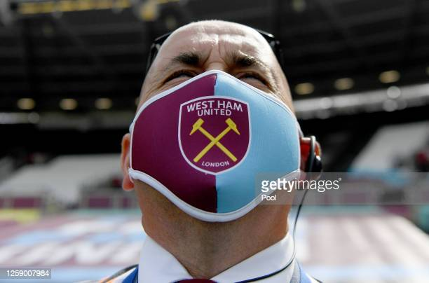 Member of staff is seen wearing a West Ham United face mask prior to the Premier League match between West Ham United and Aston Villa at London...