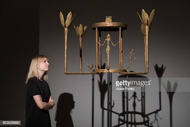 A member of staff looks at Lustre avec femme homme et iseau 1952 by Alberto Giacometti Picasso on February 22nd 2018 at the preview for Sotheby's...