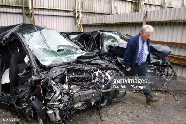 A member of staff looks at the remains of the Ford Mondeo and Audi cars at a recovery yard in Newry County Down after five people died in a head on...