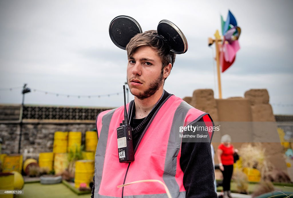 A member of staff looks on at Banksy's Dismaland on September 10, 2015 in Weston-Super-Mare, England.