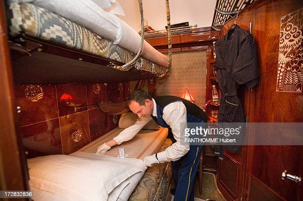 A member of staff make a bed on the Venice Simplon Orient Express train on February 28 2013 at the Gare De L'Est Station in Paris The train...