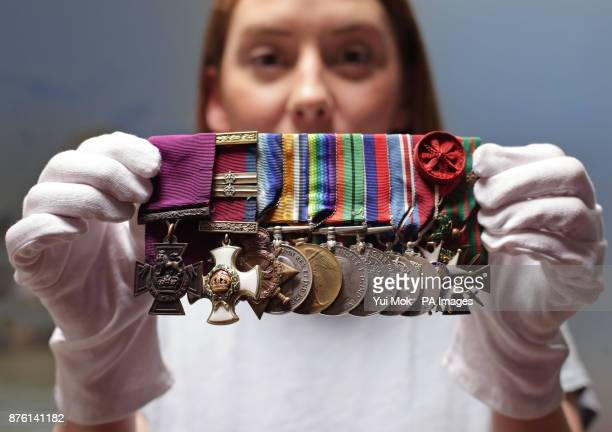 Member of staff Nancy DillonMalone holding up a set of medals that were awarded to ViceAdmiral Gordon Campbell Royal Navy including his Victoria...