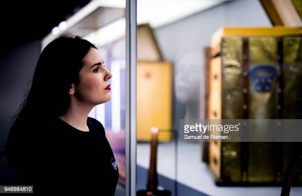 A member of staff observes a work by Lous Vuitton during 'Time Capsule' by Louis Vuitton Exhibition on April 16 2018 in Madrid Spain