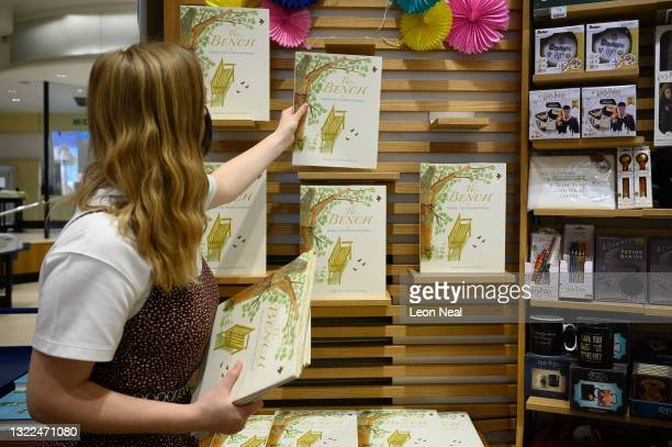"""Member of staff places copies of Meghan Markle's book """"The Bench"""" on a display in Europe's largest bookstore Waterstones Piccadilly, on June 08, 2021..."""