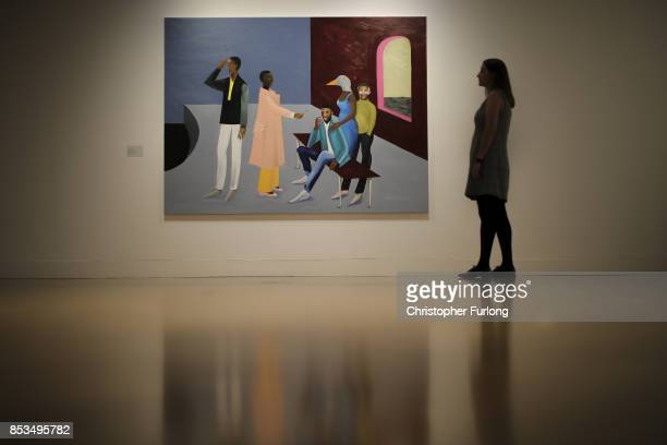 A member of staff poses for the media next to Le Rodeur The Exchange 2016 by artist Lubaina Himid during a press preview for the 2017 Turner Prize at...