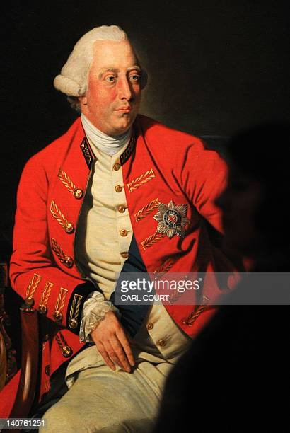 A member of staff poses next to a1771 portrait by German artist Johan Zoffany of Britain's King George III entitled George III at the Royal Academy...