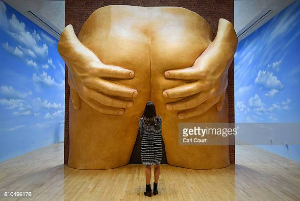 A member of staff poses next to an installation by British artist Anthea Hamilton entitled 'Project for a Door' during a press preview for the 2016...