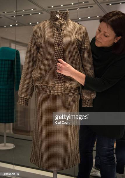 A member of staff poses with a brown tweed day suit designed by Bill Pashley and worn by Diana on her honeymoon in Balmoral in 1981 during a preview...
