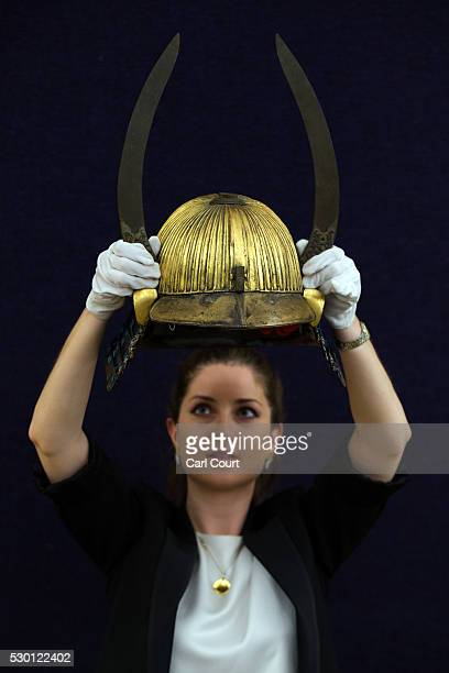 A member of staff poses with a suji kabuto at Bonhams auction house on May 10 2016 in London England Forming part of the Fine Japanese Art sale on...