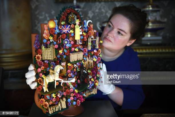 A member of staff poses with a 'Tree of Life' art piece given to Queen Elizabeth II by President Enrique Pena Nieto of Mexico during his 2015 State...