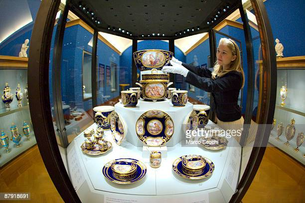 A member of staff positions pieces from the Sevres dinner service the most expensive dinner and dessert service ever made at the Queen's Gallery...