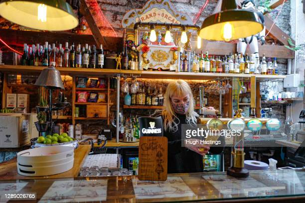 Member of staff pours a drink at the Chintz Emporium on December 2, 2020 in Falmouth, United Kingdom. Last night MPs voted in favour of government...