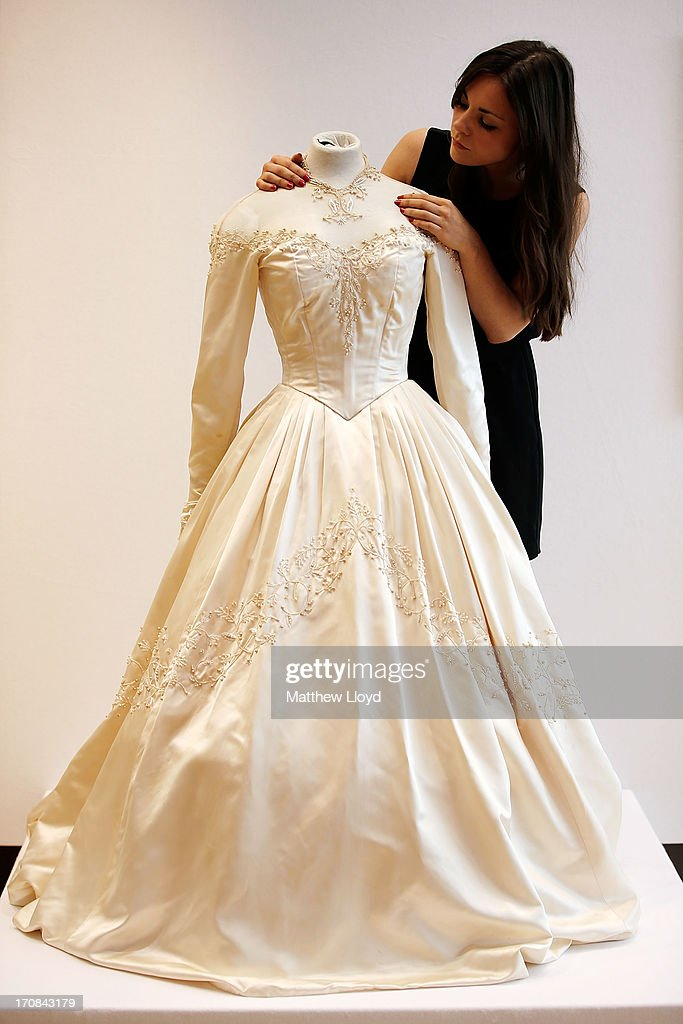 A Member Of Staff Prepares A Dress, Worn By Elizabeth Taylor For Her First  Wedding