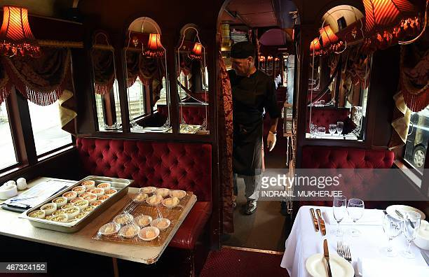 A member of staff prepares one of the Colonial Tramcar Restaurant vintage trams prior to the lunch service at the depot in Melbourne on March 23 2015...